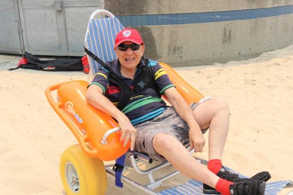 Ken in wheelchair on the beach